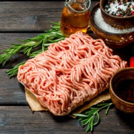 Raw ground beef with tomatoes and spices.